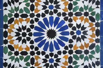 Complex, beautiful Moroccan mosaic, in a traditional Moorish, Islamic design covering walls, floors and fountains, in Marrakesh, Morocco