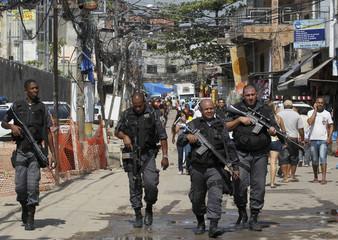 Policemen patrol a day after invading the Alemao slum in Rio de Janeiro