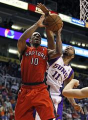 Toronto Raptors guard DeRozan has his shot blocked by Phoenix Suns' Morris during the second half of their NBA basketball game in Phoenix, Arizona