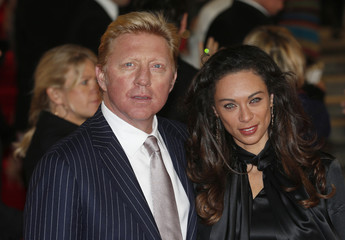 Former German tennis champion Boris Becker and his wife Lilly arrive for the royal world premiere of the new 007 film Skyfall at the Royal Albert Hall in London