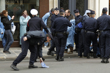 French police surround a small group of some thirty to forty nurse-anesthesiologists who demonstrate outside the Elysee Palace in Paris