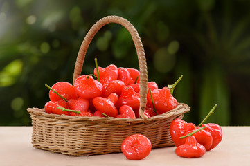 Wicker basket filled with red fruits