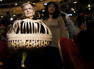 """A woman dressed in a costume attends the draw of Spain's Christmas Lottery """"El Gordo"""" in Madrid"""