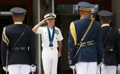 U.S. Navy Admiral Harry Harris, Commander of U.S. Pacific Fleet  salutes during a welcoming ceremony for him at the Philippine Armed Forces headquarters at Camp Aguinaldo in Quezon City