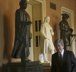 Senator Blunt of Missouri walks to working lunch on Capitol Hill in Washington