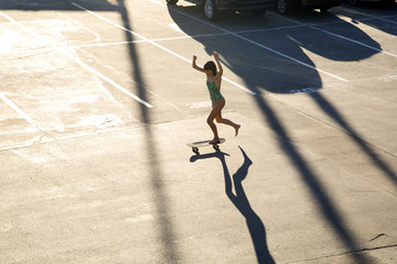 High angle view of woman skateboarding in skateboard park