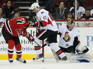 Ottawa Senators goalie Anderson makes a save on a shot by New Jersey Devils left wing Steckel in the first period of their NHL hockey game in Newark