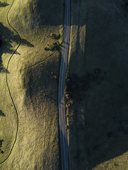 Aerial view of empty country road amidst landscape