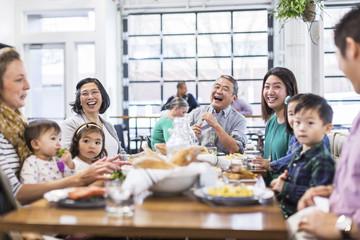 Multi generation family having lunch at restaurant