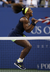 Williams of the U.S. celebrates after defeating Azarenka of Belarus in their women's singles finals match at the U.S. Open tennis tournament in New York
