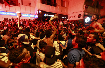 People gather during a protest to demand the ouster of the Islamist-dominated government, in Tunis