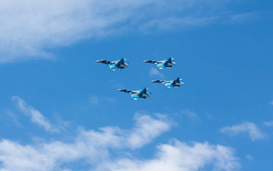 War planes in blue sky with clouds at the victory parade in the capital of Kazakhstan Astana in 2017