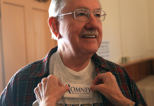 Bill Moriarty has Mitt Romney stickers placed on his shirt at Genoa Town Hall during a Republican caucus in Genoa