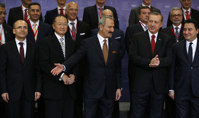 Turkish officials pose with World Bank President  Jim Yong Kim during the 8th meeting of the Investment Advisory Council for Turkey in Istanbul