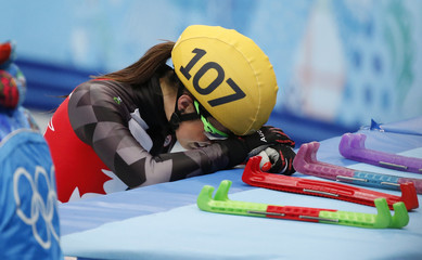 Canada's Valerie Maltais reacts after she crashed out in the women's 1,000 metres short track speed skating semifinal event at the Iceberg Skating Palace during the 2014 Sochi Winter Olympics