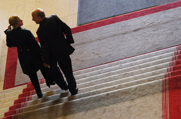 Swiss Finance Minister Merz walks with a federal usher in the Swiss Federal Palace in Bern