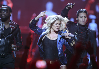 will.i.am, Stacy 'Fergie' Ferguson and Taboo of the Black Eyed Peas perform during the first day of the iHeartRadio Music Festival at the MGM Grand Garden Arena in Las Vegas