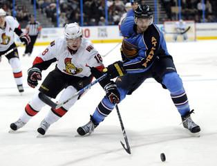 Senators center Winchester battles with Atlanta Thrashers defenseman  Hainsey in third period of their NHL hockey game in Atlanta.