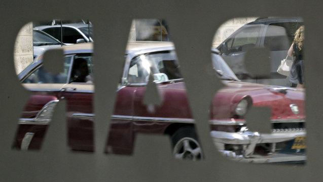 """A car on the street is seen from inside newly opened bar """"Sloppy Joe's"""" in Havana"""