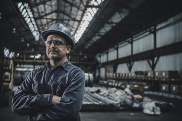 Portrait of male worker standing in metal industry