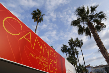An official poster of the 69th Cannes Film Festival is seen on the Festival Palace in Cannes