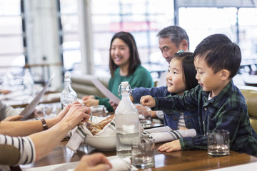 Family eating food in restaurant