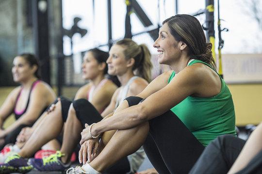 Smiling women relaxing in gym