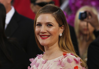 Drew Barrymore arrives at the 71st annual Golden Globe Awards in Beverly Hills