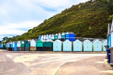 Beach huts by a promenade at Bournemouth beach