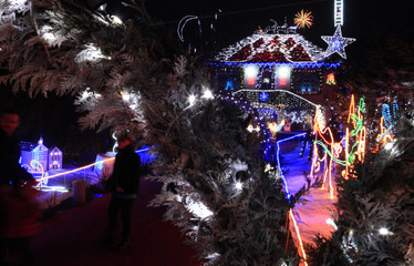 People visit the Colson family home, decorated with Christmas lights, in Anhiers, near Douai