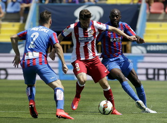Atletico Madrid's Siqueira controls the ball against Levante's Ivan and Sissoko during their Spanish first division soccer match at the Ciudad de Valencia stadium in Valencia