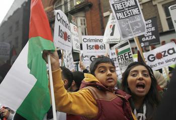 Pro-Palestinian demonstrators protest outside the Israeli Embassy in London