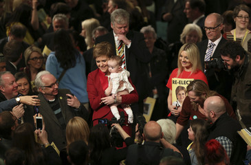 Scotland's First Minister Nicola Sturgeon holds a baby during the launch of the SNP manifesto for the Holyrood election, in Edinburgh