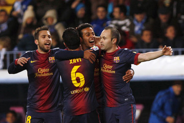 Barcelona's Thiago is congratulated by his team mates after scoring a goal against Malaga during their Spanish First Division soccer match  in Malaga