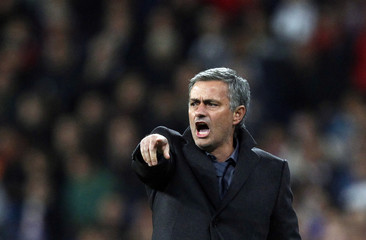 Real Madrid's coach Jose Mourinho gestures during their Spanish King's Cup soccer match against Murcia at the Santiago Bernabeu stadium in Madrid