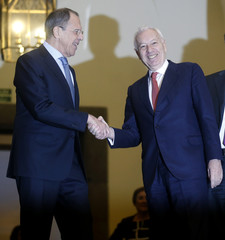 Russian Foreign Minister Sergei Lavrov shakes hands with his Spanish counterpart Jose Manuel Garcia-Margallo after his arrival for a meeting at the foreign ministry in Madrid