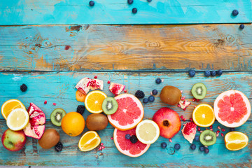 Colorful fruit on wood background