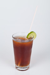 Ice tea with lemon slice on neutral background