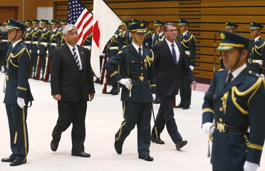 Japan's Defense Minister Nakatani and US Secretary of Defense Carter inspect honour guard at defense ministry in Tokyo