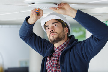 Fototapeta Contractor fitting ceiling vent obraz