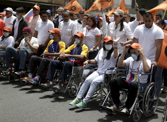 Opposition supporters on hunger strike take part in a demonstration in wheelchairs in Caracas