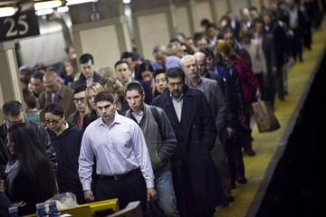 Commuters get off a train at Grand Central Terminal in New York