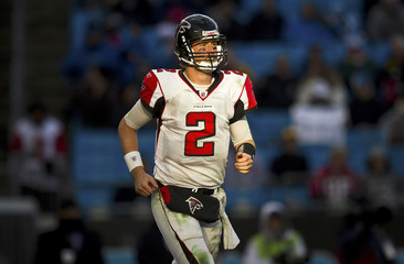 Atlanta Falcons quarterback Matt Ryan runs off the field after a turnover against the Carolina Panthers during an NFL football game in Charlotte