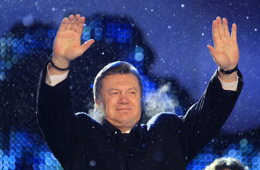 Ukraine's presidential candidate Yanukovich greets his supporters during a concert in Kiev