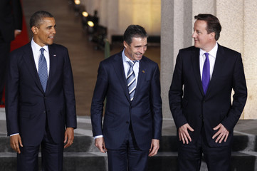 U.S. President Barack Obama, Secretary General of NATO Anders Fogh Rasmussen and British Prime Minister David Cameron prepare to pose for a family photo at the NATO Summit in Chicago