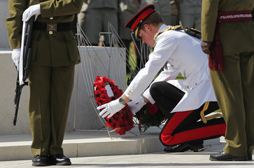Harry places a wreath during a ceremony at the World War Two Commonwealth Cemetery in Cassino