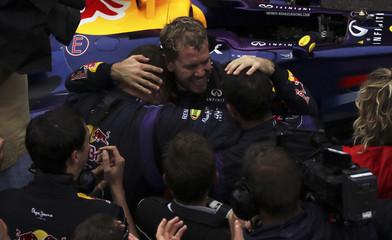 Sebastian Vettel of Germany celebrates winning the Brazilian F1 Grand Prix with his team at the Interlagos circuit in Sao Paulo