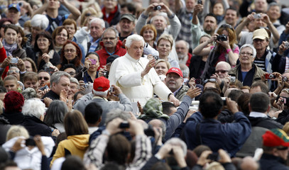 Pope Benedict XVI waves as he leads his weekly audience in Saint Peter's Square at the Vatican