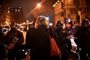 A young woman argues with riot police as they block her from reaching an inaugural ball that protesters against U.S. President Donald Trump are attempting to disrupt after Trump's inauguration in Washington