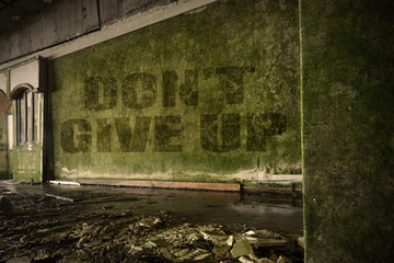 text dont give up on the dirty wall in an abandoned ruined house